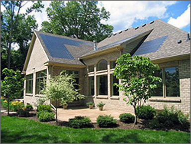 Thin-film solar roof tiles on a house