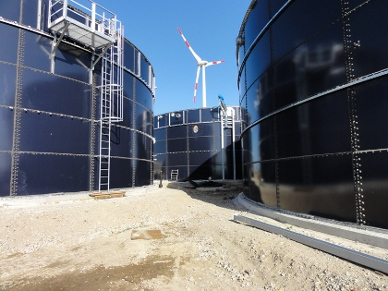 Wind Turbine behind Tanks